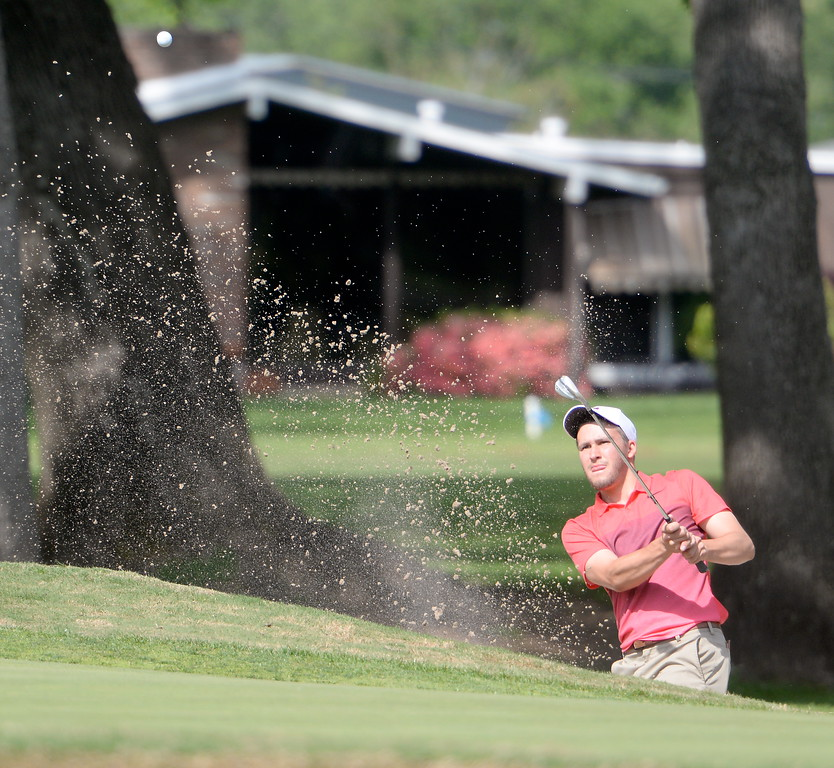 . Chris Colla digs out of a bunker on the 8th hole during CSUC Men\'s CCAA Championship golf at Butte Creek Country Club in Chico, Calif. Tues. April 24, 2018. (Bill Husa -- Enterprise-Record)