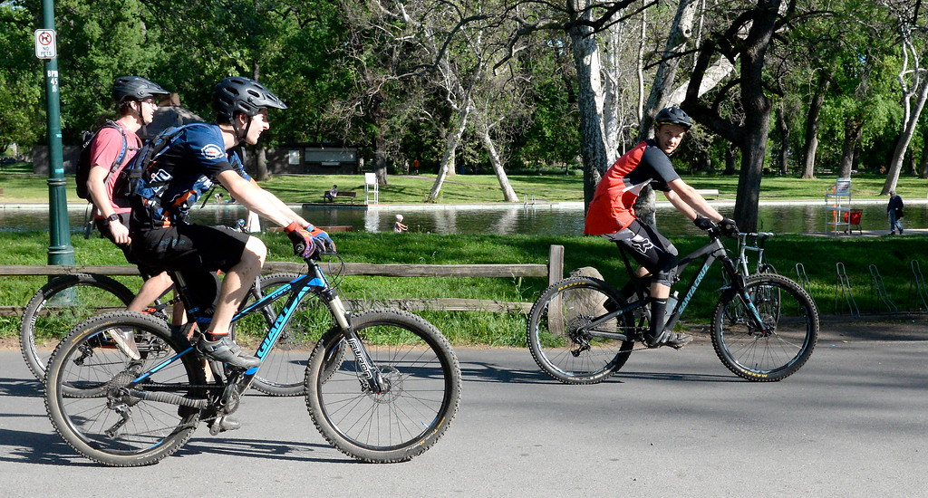 . A group on mountain bikes ride past Sycamore Pool near One Mile Recreation Area in Chico, Calif. Monday April 23, 2018. (Bill Husa -- Enterprise-Record)