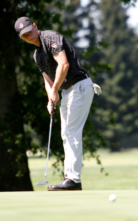 . Kelley Sullivan watches the bal roll toward the hole as the Chico State mens golf team faces Cal State Monterey Bay in match play Wednesday, April 25, 2018, for the California Collegiate Athletic Association championship at the Butte Creek Country Club in Chico, California. (Dan Reidel -- Enterprise-Record)