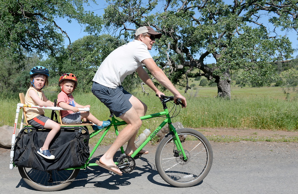 . Superdad Aren Timmel of Chico gives his two children Arlo, 2 and Jasper, 5 a ride on his bike with a custom kid rack in Upper Bidwell Park in Chico, Calif. Friday April 20, 2018. (Bill Husa -- Enterprise-Record)