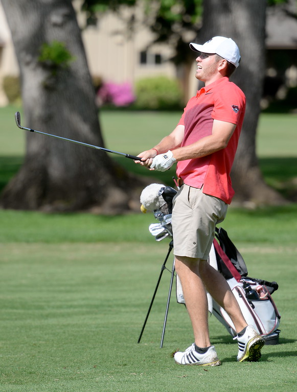 . Colby Dean watches his approach on the 8th hole during CSUC Men\'s CCAA Championship golf at Butte Creek Country Club in Chico, Calif. Tues. April 24, 2018. (Bill Husa -- Enterprise-Record)