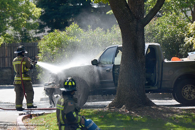 Firefighter Casey Silver puts water on the remains of a Ford pickup that caught fire Wednesday, March 30, 3016, on the 1600 block of Forest Avenue in Chico, California. (Dan Reidel -- Enterprise-Record)