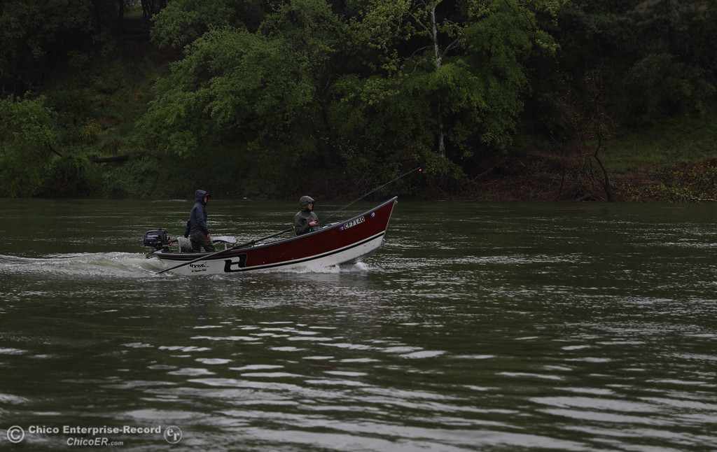 . Boti Trimmel and Kayla Katayama, despite the rain, fish for steelhead in the Feather River by Riverbend Park, April 6, 2018, in Chico, California. (Carin Dorghalli -- Enterprise-Record)