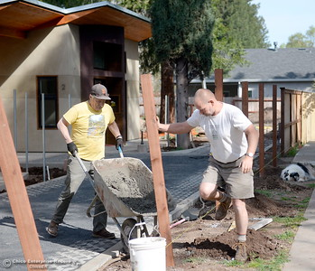 Owner/Builder Laurie Norton and Contractor/Friend Tim Simonds (yellow shirt) work on the driveway and fence area where Norton is building three small houses along Humboldt Road in Chico, Calif. Tues. April 3, 2018. Inside of the 576-square-foot houses are high ceilings and a walnut countertop.  (Bill Husa -- Enterprise-Record)