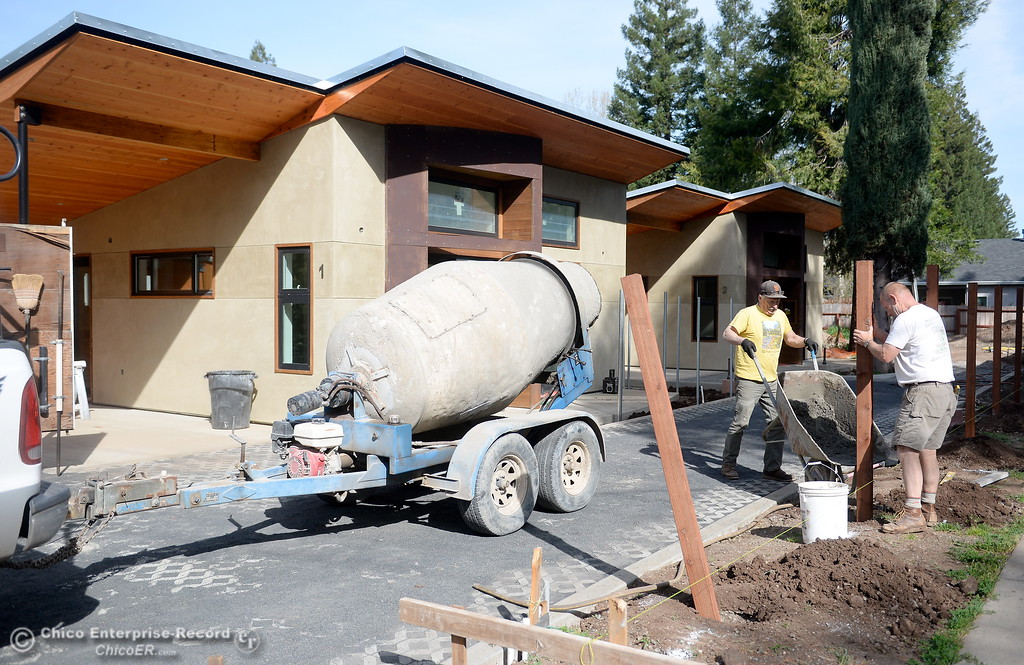 . Owner/Builder Laurie Norton and Contractor/Friend Tim Simonds (yellow shirt) work on the driveway and fence area where Norton is building three small houses along Humboldt Road in Chico, Calif. Tues. April 3, 2018. Inside of the 576-square-foot houses are high ceilings and a walnut countertop.  (Bill Husa -- Enterprise-Record)