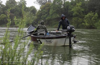 Boti Trimmel and Kayla Katayama, despite the rain, fish for steelhead in the Feather River by Riverbend Park, April 6, 2018, in Chico, California. (Carin Dorghalli -- Enterprise-Record)