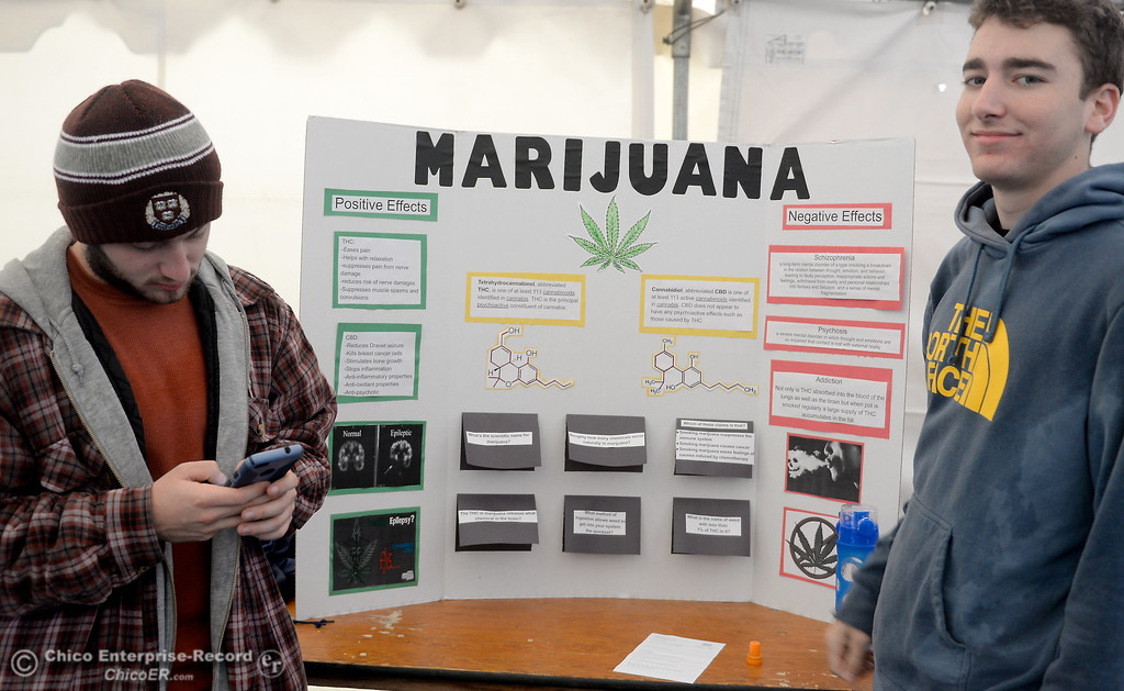 . Noah Levinson left and Steven Denicke talk about the positive and negatavie effects of marijuana during the CSUC Great Debate at City Plaza in downtown Chico, Calif. Friday, April 6, 2018. (Bill Husa -- Enterprise-Record)