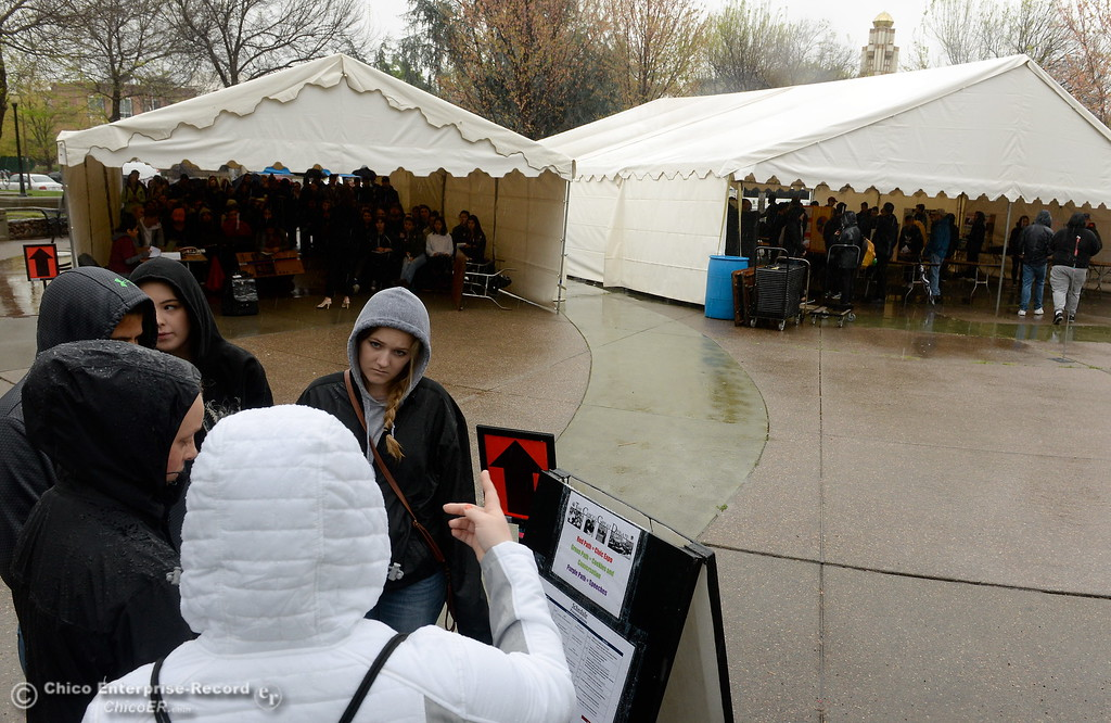 . Students battle the weather as they decide what to partake in next during the CSUC Great Debate at City Plaza in downtown Chico, Calif. Friday, April 6, 2018. (Bill Husa -- Enterprise-Record)