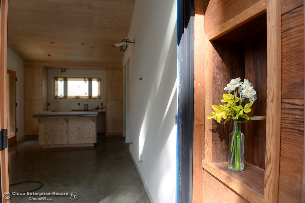. Flowers are seen in a small nook near the front door of one of three small houses being built along Humboldt Road in Chico, Calif. Tues. April 3, 2018. Inside of the 576-square-foot houses being built by Laurie Norton Owner/Builder are high ceilings and a walnut countertop.  (Bill Husa -- Enterprise-Record)