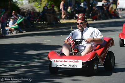 Jonathan Taylor of Chico Shrine Club down cruises down the streets of downtown Oroville during the Fiesta Days Parade, May 12, 2018,  in Chico, California. (Carin Dorghalli -- Enterprise-Record)