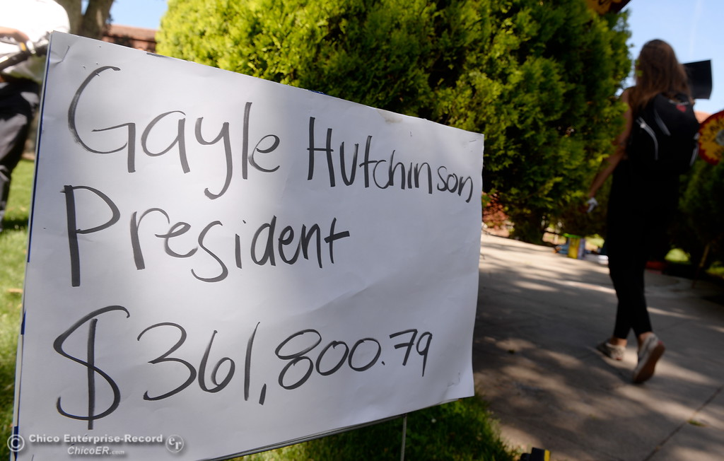 . Signs showing annual salaries of some college executives are seen while students chant and march in protest of rising tuition fees during a gathering of approx. 35 people in front of Kendall Hall on the Chico State campus in Chico, Calif. Monday May 7, 2018. (Bill Husa -- Enterprise-Record)
