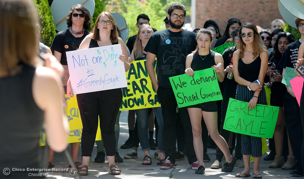 ". CSUC students hold signs while Sara Bilotta, a second year Political Science Major speaks and leads them in a chant during a protest of rising tuition fees during a gathering of approx. 35 people in front of Kendall Hall on the Chico State campus in Chico, Calif. Monday May 7, 2018. Some of the chants included phrases such as ""Who\'s University, Our University\"" and Education is a right, \""not just for the rich and white.\"" (Bill Husa -- Enterprise-Record)"