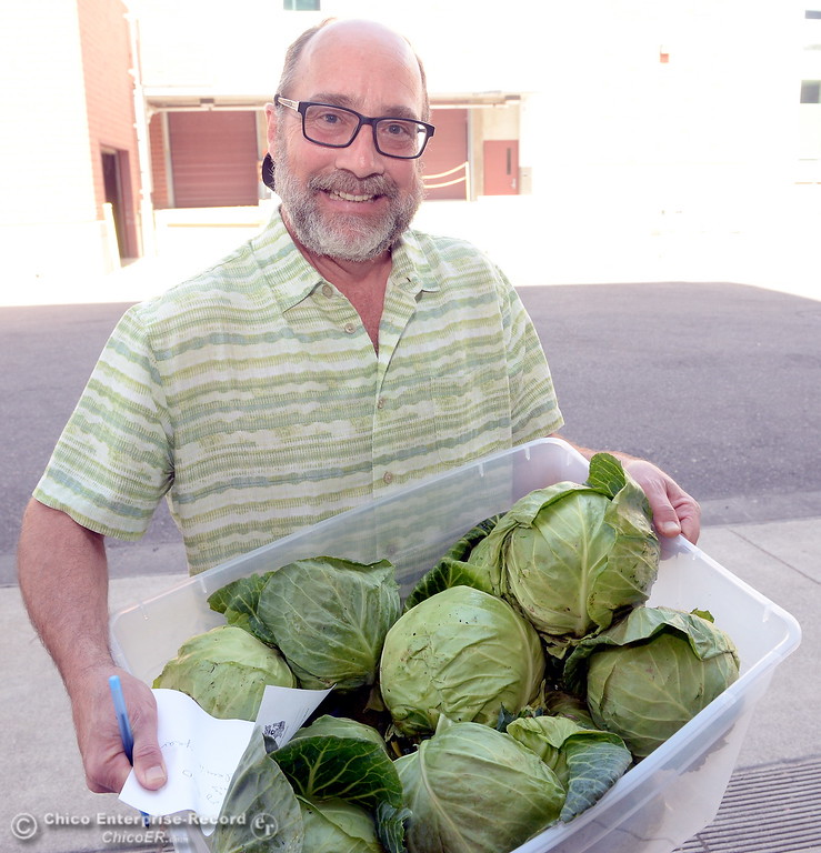 . Basic Needs Administrator Joe Picard smiles with some fresh vegetables at the Hungry Wildcat Food Pantry located at the Student Services Center room 196 on the CSUC campus Tuesday May 8, 2018. (Bill Husa -- Enterprise-Record)