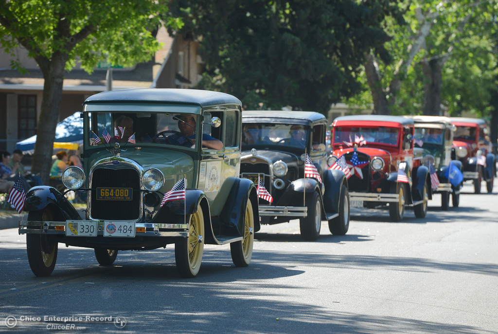 . A line of classic cars cruises down the streets of Oroville during the Fiesta Day Parade, May 12, 2018,  in Chico, California. (Carin Dorghalli -- Enterprise-Record)