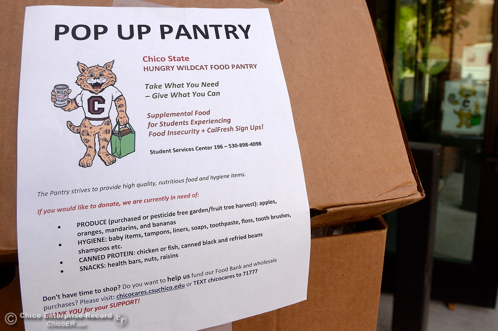 . A sign about the Pop Up Pantry is seen at the Hungry Wildcat Food Pantry located at the Student Services Center room 196 on the CSUC campus Tuesday May 8, 2018. (Bill Husa -- Enterprise-Record)