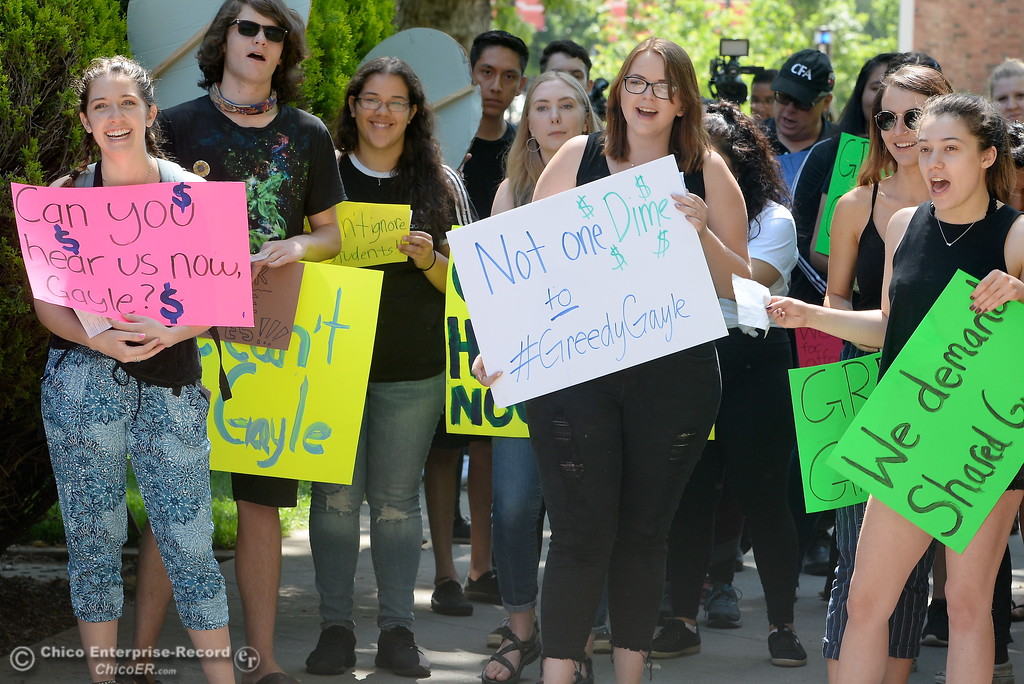 . CSUC students hold signs as they chant and march in protest of rising tuition fees during a gathering of approx. 35 people in front of Kendall Hall on the Chico State campus in Chico, Calif. Monday May 7, 2018. (Bill Husa -- Enterprise-Record)
