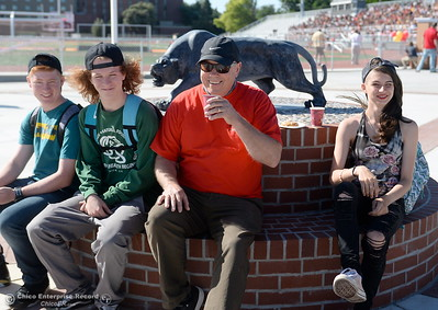 Chico High students L.J. Golde, Austin Teeter and Coral Smith at right sit with Chico High Counselor Doug Wion beside the new Panther statue after it was unvieled during a celebration of the new Chico High School stadium Friday May 11, 2018.  (Bill Husa -- Enterprise-Record)