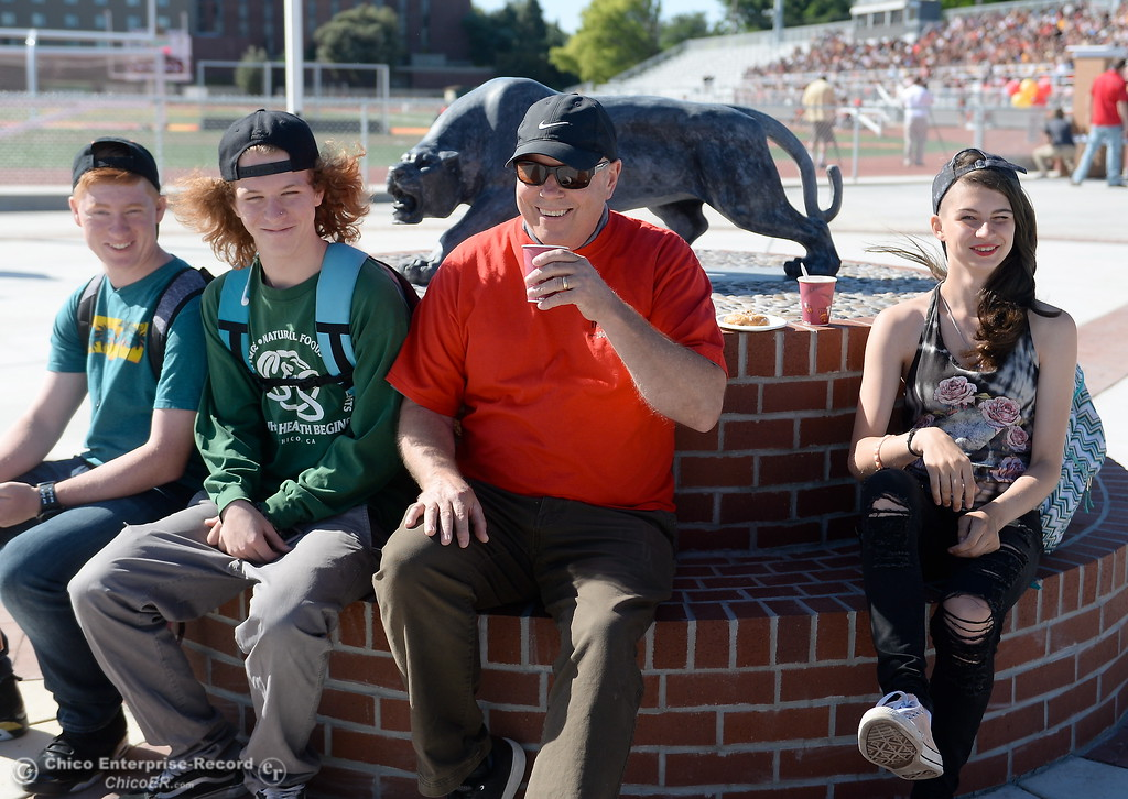 . Chico High students L.J. Golde, Austin Teeter and Coral Smith at right sit with Chico High Counselor Doug Wion beside the new Panther statue after it was unvieled during a celebration of the new Chico High School stadium Friday May 11, 2018.  (Bill Husa -- Enterprise-Record)