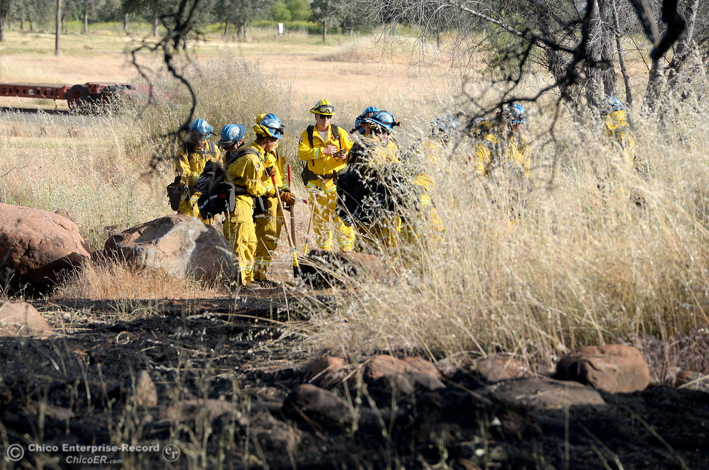 . Firefighters mop up a series of spot fires that started along Skyway above Chico, Calif. Thursday May 10, 2018.  (Bill Husa -- Enterprise-Record)