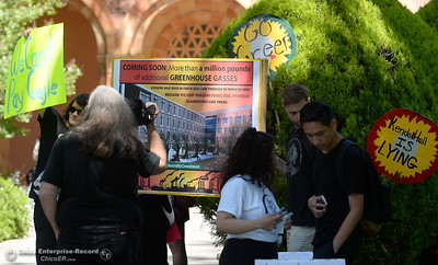 CSUC students hold signs as they chant and march in protest of rising tuition fees during a gathering of approx. 35 people in front of Kendall Hall on the Chico State campus in Chico, Calif. Monday May 7, 2018. (Bill Husa -- Enterprise-Record)
