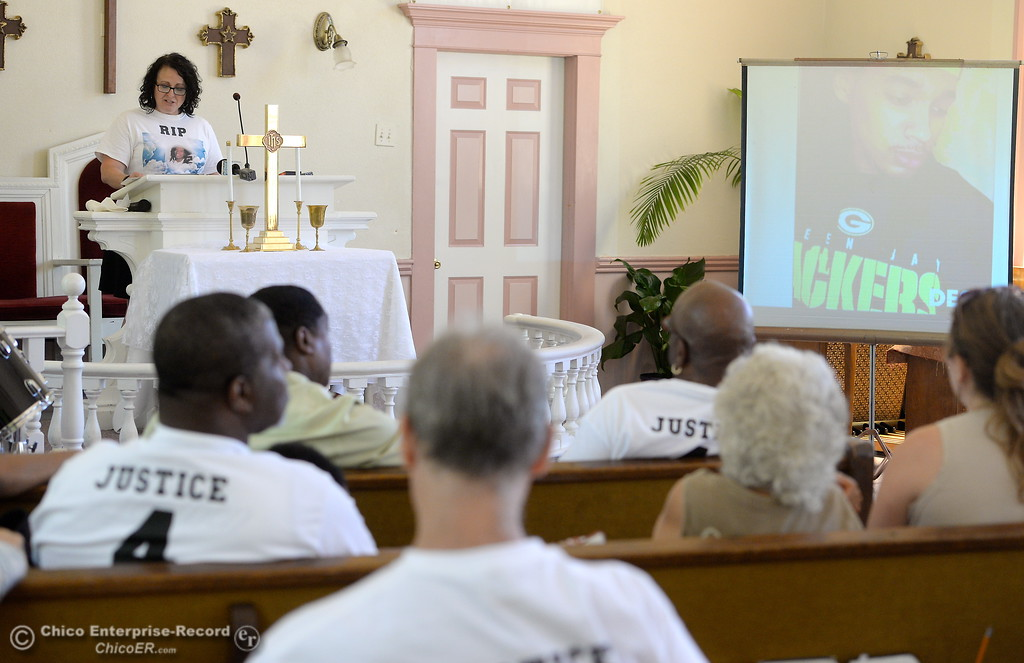 . A projector shows photos of Desmond Phillips as Erica Traverso, a member of Showing Up for Racial Justice (SURJ) speaks to the group during a press conference to discuss the facts of the Desmond Phillips case at the Bethel AMA Church in Chico, Calif. Mon. May 22, 2017. (Bill Husa -- Enterprise-Record)