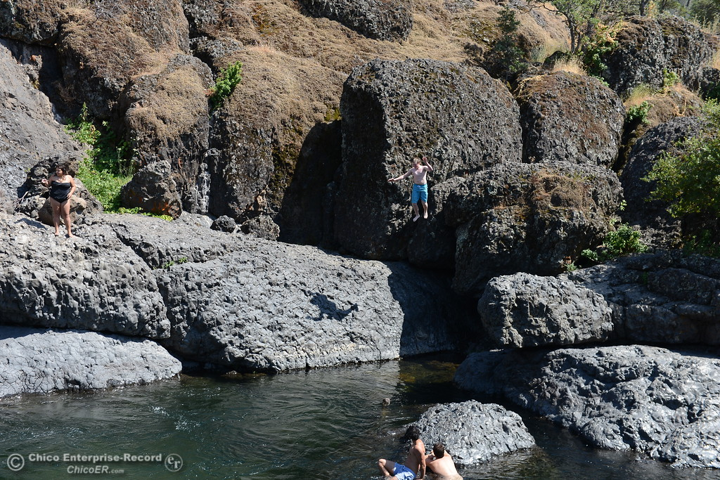 . Zach Ausland jumps into Big Chico Creek. (Dan Reidel -- Enterprise-Record)