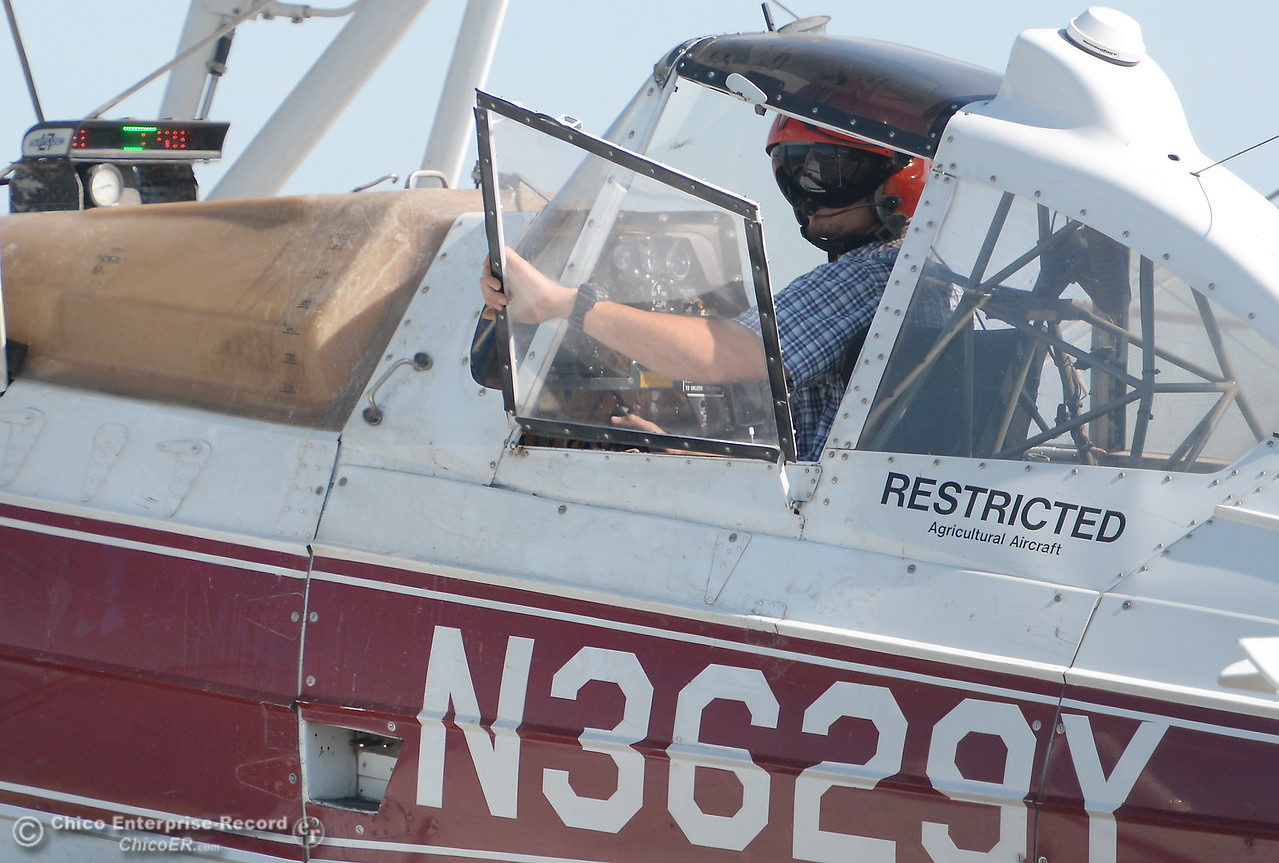 Pilot C.J. Garrity plants rice from the air at Gorrill Ranch in Durham, Calif. Tues. May 23, 2017. (Bill Husa -- Enterprise-Record)