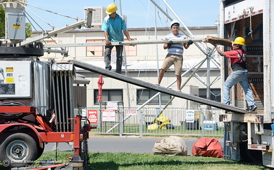 A crew works on setting up a ride as activity continues in preparation of the Silver Dollar Fair Tues. May 23, 2017. (Bill Husa -- Enterprise-Record)