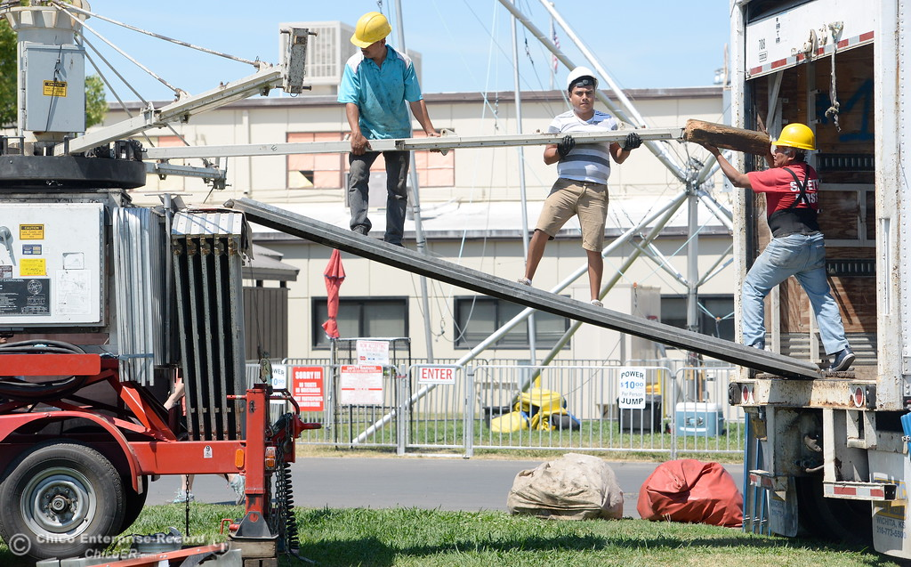 . A crew works on setting up a ride as activity continues in preparation of the Silver Dollar Fair Tues. May 23, 2017. (Bill Husa -- Enterprise-Record)