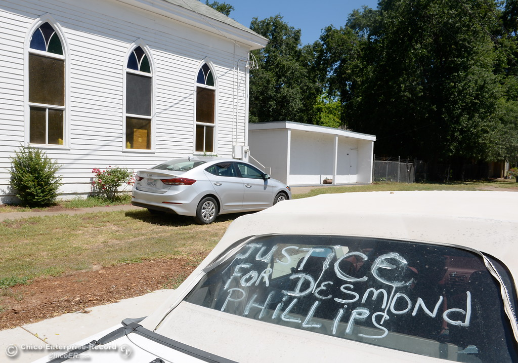 ". A car window is marked with a ""Justice for Desmond Phillips message seen during a press conference to discuss the facts of the Desmond Phillips case at the Bethel AMA Church in Chico, Calif. Mon. May 22, 2017. (Bill Husa -- Enterprise-Record)"