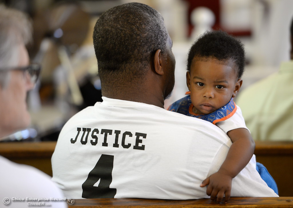 ". Wearing ""Justice 4 Desmond\"" t-shirt Uncle Willie Howard holds 1-year-old Mario White Jr. while approx. 25 people attended a press conference to discuss the facts of the Desmond Phillips case at the Bethel AMA Church in Chico, Calif. Mon. May 22, 2017. (Bill Husa -- Enterprise-Record)"