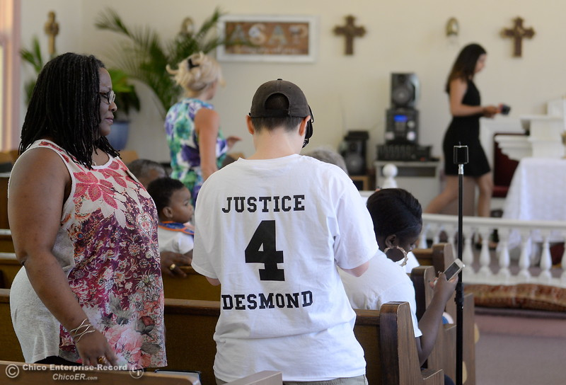 "Several people wear ""Justice 4 Desmond"" shirts as approx. 25 people attended a press conference to discuss the facts of the Desmond Phillips case at the Bethel AMA Church in Chico, Calif. Mon. May 22, 2017. (Bill Husa -- Enterprise-Record)"