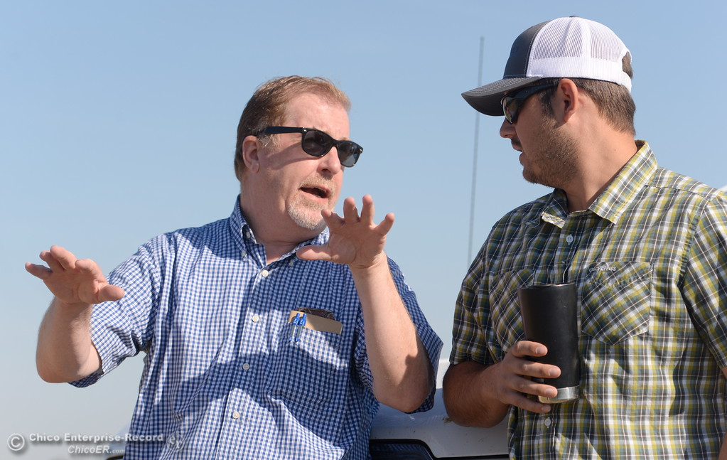 . Ranch Manager Danny Robinson at left talks with Production Manager Nate Enos as rice gets planted from the air at Gorrill Ranch in Durham, Calif. Tues. May 23, 2017. (Bill Husa -- Enterprise-Record)