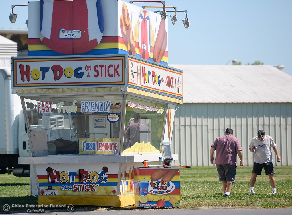 . A few people, a couple of food booths and one ride begin the fair setting up at the Silver Dollar Fairgrounds in Chico, Calif. Mon. May 22, 2017. (Bill Husa -- Enterprise-Record)