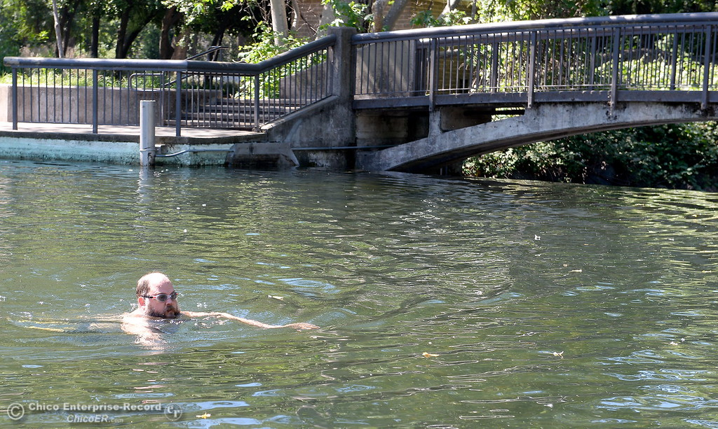 ". Ken Anderson of Chico enjoys a swim at Sycamore Pool at the One Mile Recreation Area in Bidwell Park Tuesday. Anderson said ""I like to get a little cold, It\'s refreshing.\""   The City will delay their opening of the pool this year due to high water. Signs are on display warning swimmers to swim at their own risk when no lifeguard is on duty and also to note that debris piled up on the bottom of the pool makes the deep end much shallower so no diving is permitted Tues. May 23, 2017. (Bill Husa -- Enterprise-Record)"