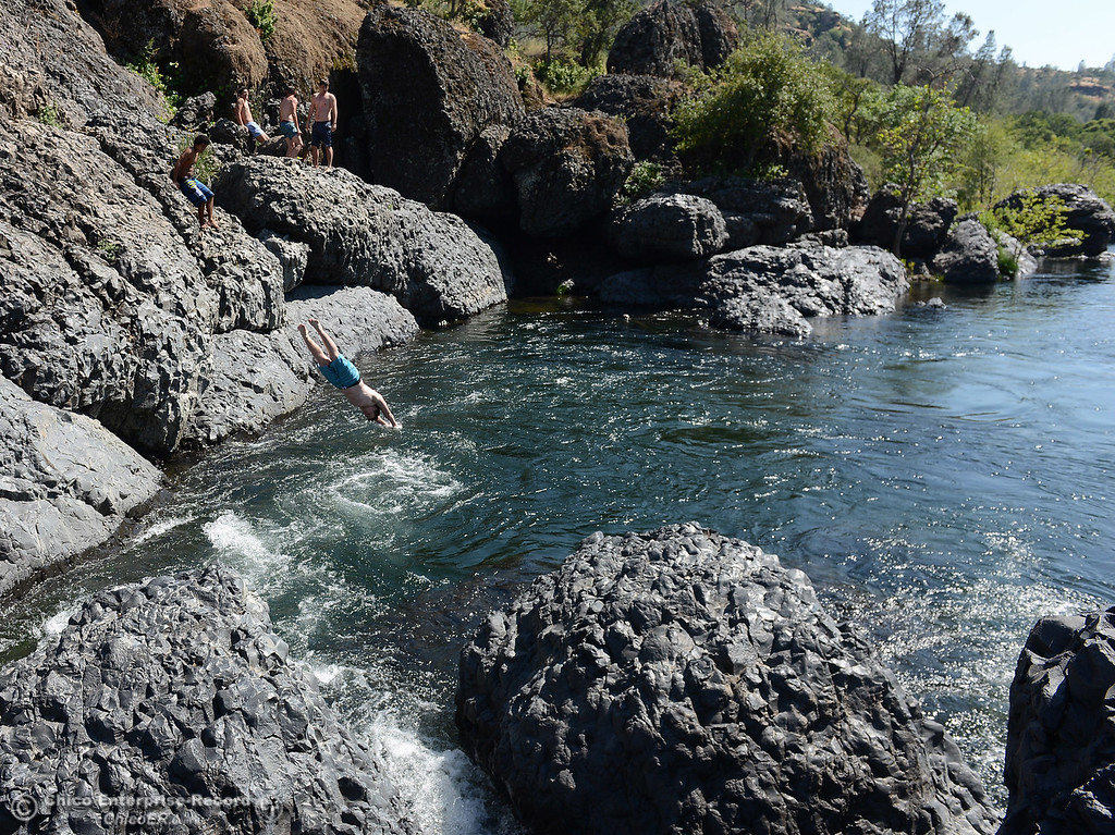 . ZachAusland dives into Bear Hole as he and other Chico High seniors swim afterschool Friday, May 26, 2017, in Chico, California.  (Dan Reidel -- Enterprise-Record)
