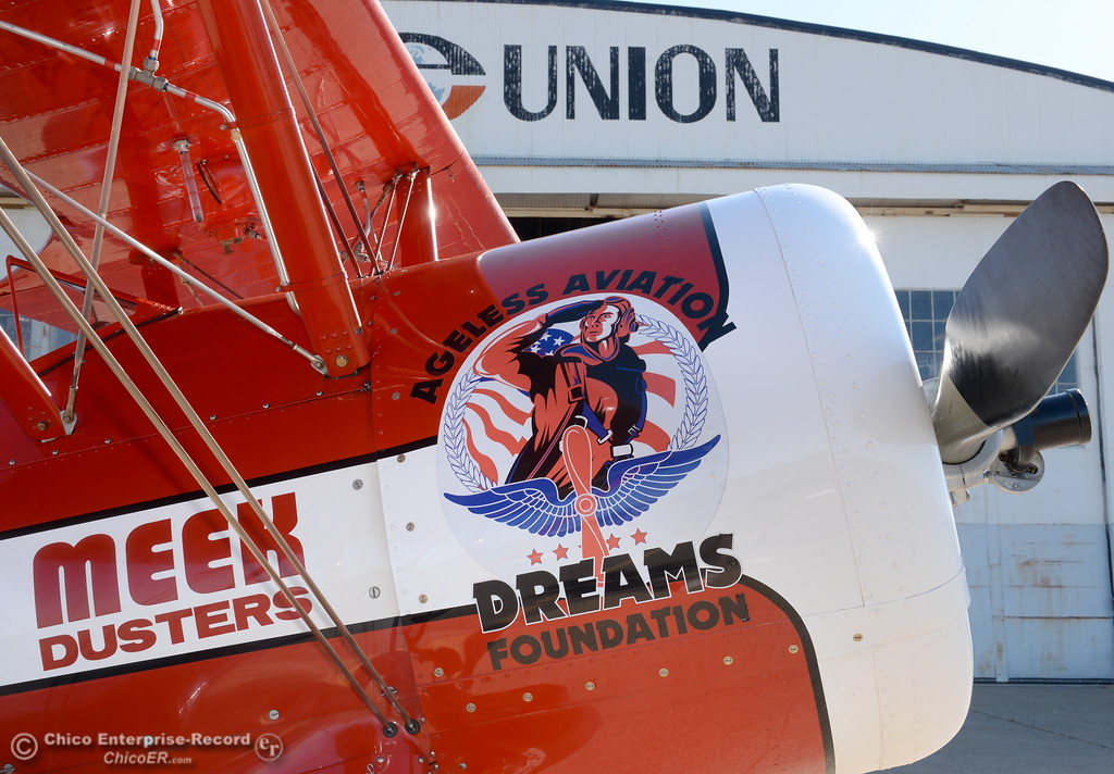 . An Ageless Aviation Dreams Foundation Boeing Stearman waits as Chico California residents from The Terraces get ready for a flight at the Chico Airport in Chico, Calif. Tuesday May, 1, 2018.   (Bill Husa -- Enterprise-Record)