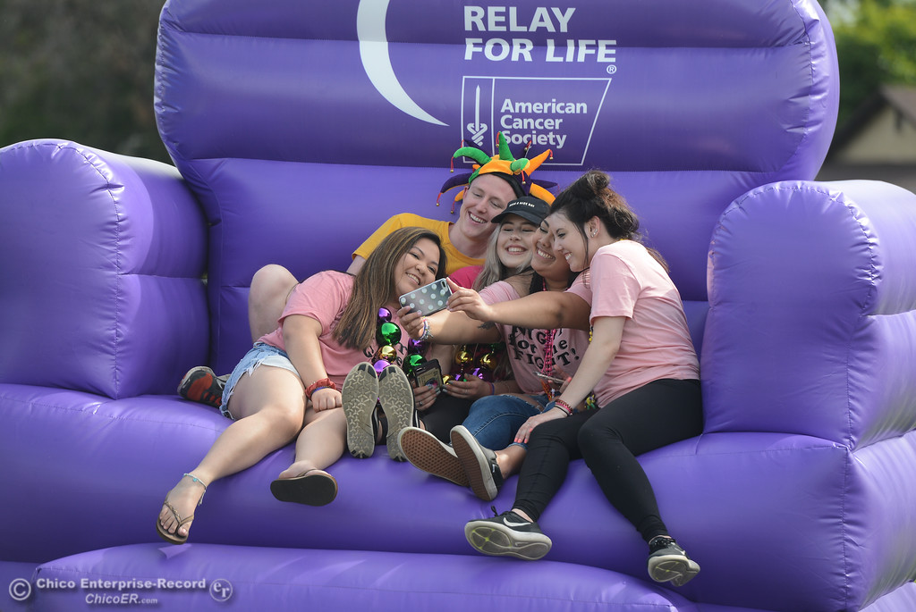 . Mikaela Calma, Billy Roles, Sami Laine, Alicia Padilla and Lexie Greminger take a selfie in an inflatable chair during Relay for Life, May 5, 2018,  in Chico, California. (Carin Dorghalli -- Enterprise-Record)