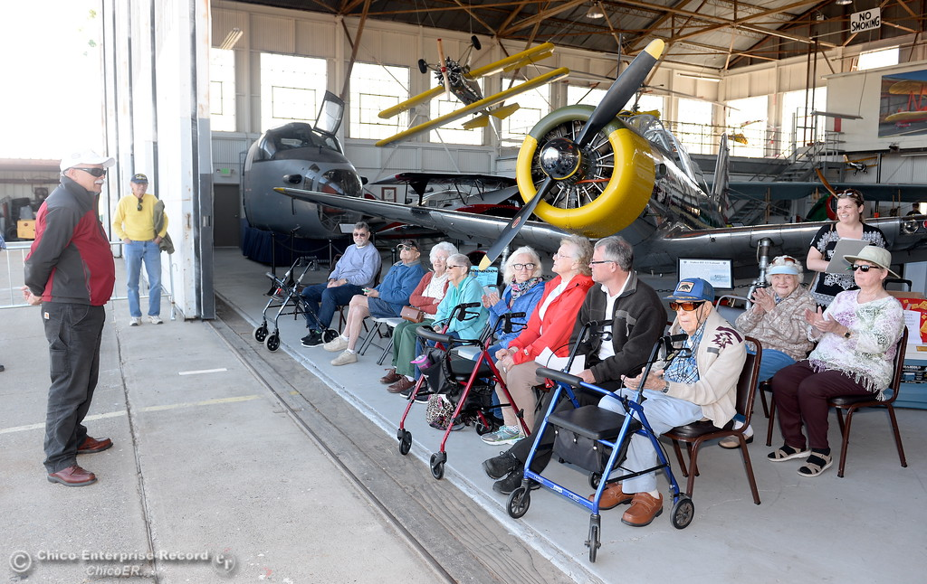 . Ageless Aviation Pilot Chris Culp at left talks to a group of seniors before they take a flight in a Boeing Stearman Tuesday May, 1, 2018.   (Bill Husa -- Enterprise-Record)