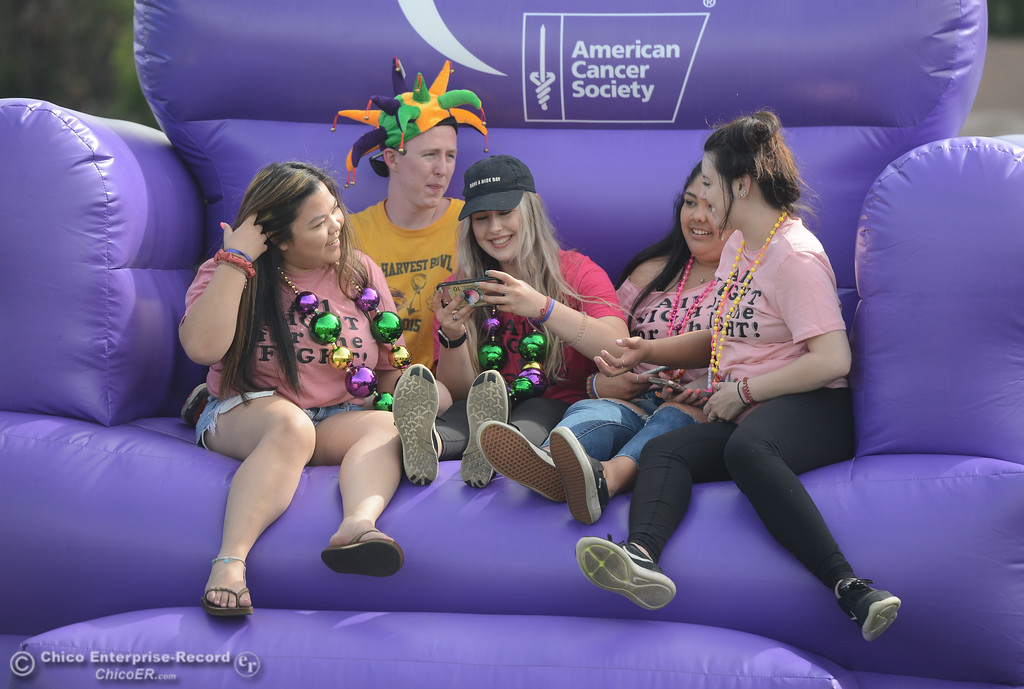 . Mikaela Calma, Billy Roles, Sami Laine, Alicia Padilla and Lexie Gremingersit in an inflatable chair during Relay for Life, May 5, 2018,  in Chico, California. (Carin Dorghalli -- Enterprise-Record)