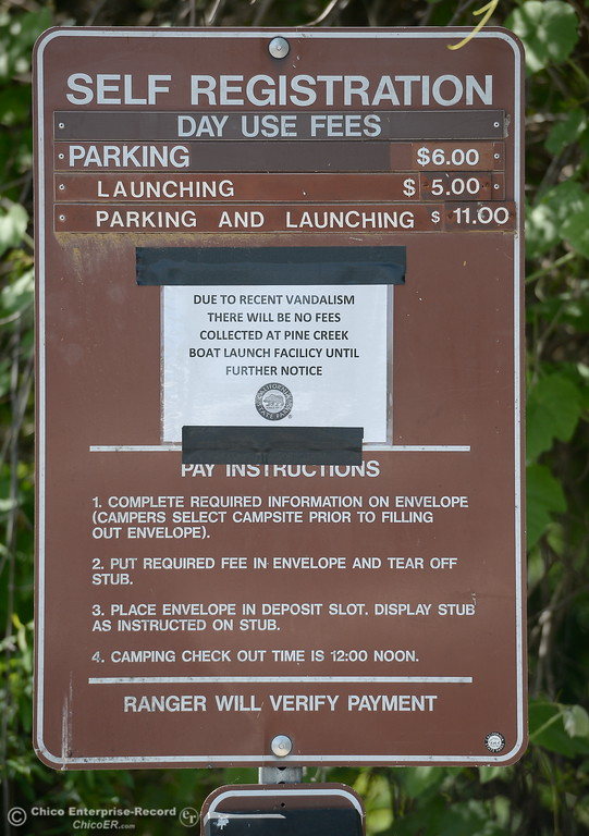 . A sign posted at the Pine Creek Boat Launch says no fees are currently collected at the location due to recent vandalism in Chico, Calif. Friday May 4, 2018. (Bill Husa -- Enterprise-Record)