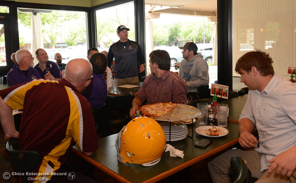 . Mark Cooley, center, coach of the South\'s 11-man football squad, introduces himself as players and coaches meet Thursday, June 8, 2017, for the Lions All-Star football game kickoff luncheon at Round Table Pizza on Pillsbury Road in Chico, California. (Dan Reidel -- Enterprise-Record)