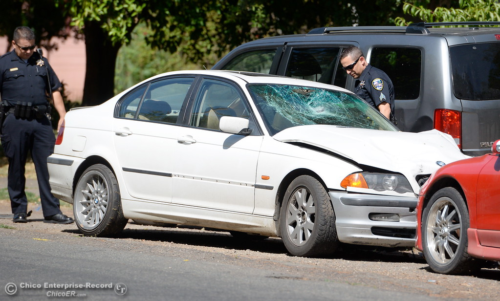 . A man was injured in a vehicle vs bicycle hit and run near the intersection of Humboldt Ave. and Olive St. in Chico, Calif. Monday June 5, 2017. The driver of the white BMW fled the scene by jumping into a black pickup, the bicycle rider was transported to Enloe. (Bill Husa -- Enterprise-Record)