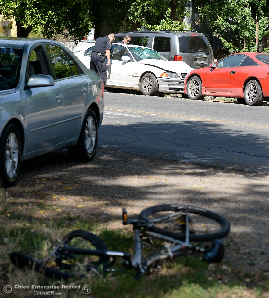 A man was injured in a vehicle vs bicycle hit and run near the intersection of Humboldt Ave. and Olive St. in Chico, Calif. Monday June 5, 2017. The driver of the white BMW fled the scene by jumping into a black pickup, the bicycle rider was transported to Enloe. (Bill Husa -- Enterprise-Record)