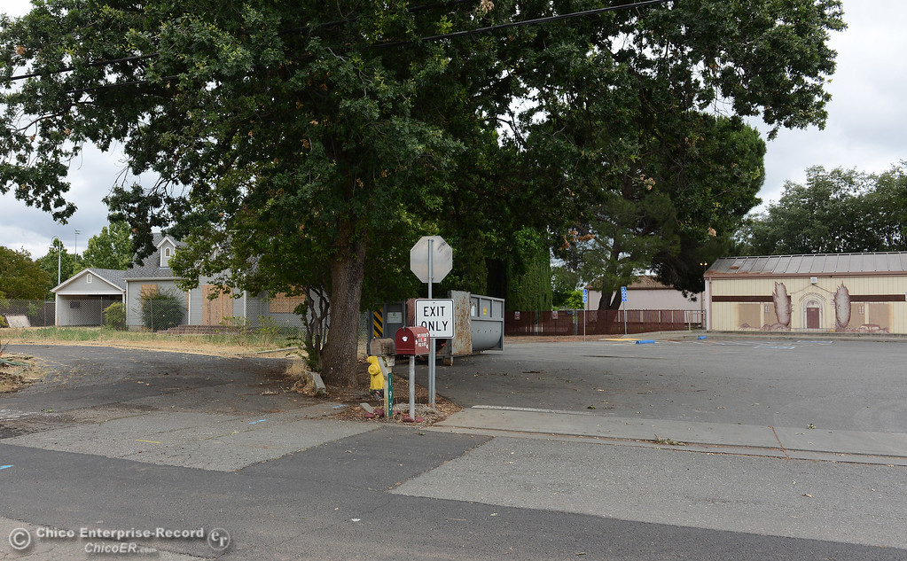 . A fenced off, boarded-up house, at left, seen Thursday, June 8, 2018, is adjecent to Shasta School, at right, in Chico, California. The Chico Unified School District bought the property with plans to expand Shasta School, but the district first has to remove soil containing lead and  termiticide. (Dan Reidel -- Enterprise-Record)