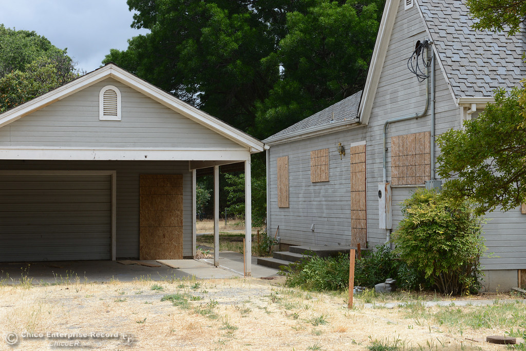 . A fenced off, boarded-up house between Shasta School and the DeGarmo Park dog park is seen Thursday, June 8, 2017, in Chico, California. The Chico Unified School District bought the property with plans to expand Shasta School, but the district first has to remove soil containing lead and  termiticide. (Dan Reidel -- Enterprise-Record)