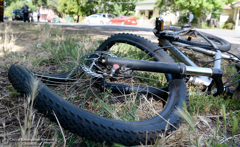 . A man was injured in a bizzare vehicle vs bicycle hit and run near the intersection of Humboldt Ave. and Olive St. in Chico, Calif. Monday June 5, 2017. The driver of the white BMW fled the scene by jumping into a black pickup, the bicycle rider was transported to Enloe. (Bill Husa -- Enterprise-Record)