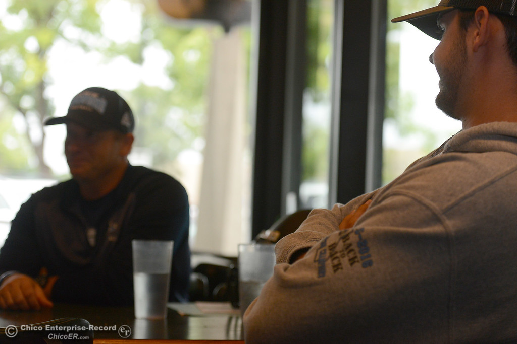 . Pleasant Valley quarterback Kyle Lindquist, right, smiles as his coach Mark Cooley talks to the Enterprise-Record. Players and coaches meet Thursday, June 8, 2017, for the Lions All-Star football game kickoff luncheon at Round Table Pizza on Pillsbury Road in Chico, California. (Dan Reidel -- Enterprise-Record)