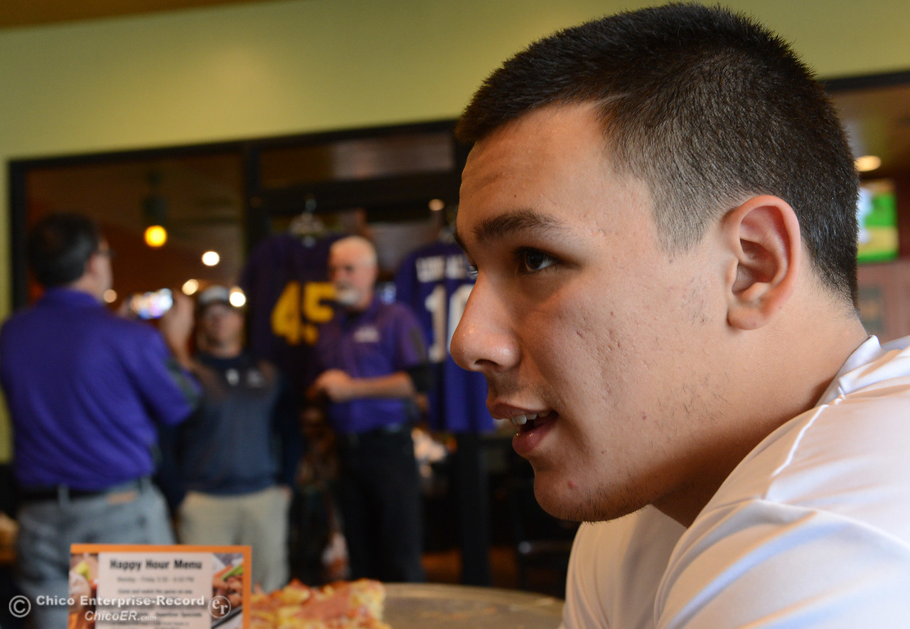 Salomon Navarro, right, talks to the Enterprise-Record as his coach Mark Cooley does an interview with the  Shasta Sports Network behind him as players and coaches meet Thursday, June 8, 2017, for the Lions All-Star football game kickoff luncheon at Round Table Pizza on Pillsbury Road in Chico, California. (Dan Reidel -- Enterprise-Record)