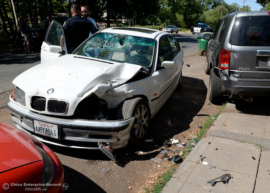 . A man was injured in a bizzare hit and run near the intersection of Humboldt Ave. and Olive St. in Chico, Calif. Monday June 5, 2017. The driver of the white BMW fled the scene by jumping into a black pickup, the bicycle rider was transported to Enloe. (Bill Husa -- Enterprise-Record)